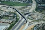 This $36 million bridge, one of three contracts that were awared to the firm for work on the overall project, had crews begin their work in March 2014, which included ramps and pavements. The 2,100-ft. (640 m) long bridge was built over the existing Inter