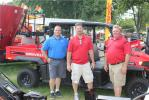 At the Ariens Gravely display building (L-R) are Bruce Tesmer of MM Lawn & Leisure, Pine Island; Mike Bell, Minnesota Equipment, Ham Lake, Minn.; and Dale Shequen, Ariens Midwest product specialist. On display is the new Gravely JSV 6000 utility vehicle.