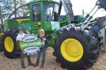 Roger Trudgeon and Courtney Harma give the new L Series skidder a thumbs-up.
