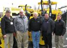 (L-R): The crew from Southeastern Equipment Company, Tim Johnson, Jon Wickline, Scott Hartzell and Mike Kress are joined by Bomag's Dale Alferink (C) to show their line of asphalt paving equipment.