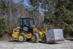 The new Cat M Series compact wheel loaders — 906M, 907M and 908M — feature Caterpillar's exclusive Optimized Z-bar loader linkage, which combines aggressive digging power with parallel lift.