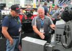 Tim Nelson (L) of E.C.K. Tree & Outdoor, based in Nedrow, N.Y., learns the latest about Western's The Striker Hopper Spreader from Fisher Snowplows' Norm Klimko.