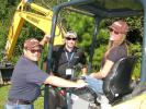 (L-R): Charlie LaColla, Chad Placido and Diana Jackson of Motor City Rentals and Sales, Peoria, Ariz., share a laugh while looking at the new Hyundai mini-excavators.