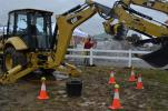 The Cat 420F series tractor loader backhoe shined in the rain-soaked demonstration area.