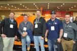 With their recently purchased LeeBoy 8616B paver (L-R) are Brandon Klein, Valley Supply and Equipment, Middle River, Md.; Michael Colette, Mike Waters and Dan Thompson, all of PCM Services, Beltsville, Md.; and Jeremiah Reinhardt of LeeBoy.