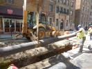 Workers lower a 12 in. (30.5 cm) pipe on W. 175 Street between Broadway and Ft. Washington Avenue.