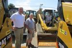 (L-R): Bill Grater of Foley CAT stands with Dominick Sempervive and Vincent D. Sempervive, both of D&V Home Improvements, Flemington, N.J. Just prior to this photo, Vincent agreed to purchase a Caterpillar 305.5E2 mini-excavator.