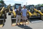 Nick Naik (L) of Zenith Construction Services Inc., Orange, N.J., and his son, Ronil, are big fans of Construction Equipment Guide and Caterpillar equipment at Foley CAT.