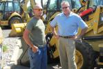 Charlie Dandeneau (L) of Concrete Construction Corp., Hackensack, N.J., meets up with Kirk Chagnon of Foley CAT during the 1-Day Sales Event.