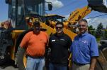 The town of Middlebury, N.Y., recently purchased a Hyundai 757 loader.  (L-R) are Town of Middlebury Highway Superintendent Jim Smart; Matt West, Hyundai factory representative; and Greg Newell, president of George & Swede.