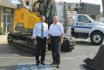 Rep. Lou Barletta (L) and Mike Liptak, president of Highway Equipment & Supply, pose for a photo during the congressman's recent visit to the company.