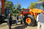 Open house guests inspect a Doosan DL550 wheel loader during the Oct. 16 event.