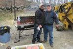 Vincent Cesarino (L), branch manager of Vermeer's Holbrook, N.Y., location and Kent Steinberger, branch manager of Vermeer's Middletown, Pa., location prepare lunch for the event.
