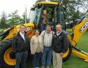 (L-R): Walsh Equipment's Charlie Walsh catches up with longtime customers Cora, Shawn and Lucas Passauer of Passauer Excavation Inc., based in West Hickory, Pa., and JCB factory representative Bob Freund.