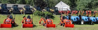 A tractor lot is situated across the road from the Milford location.