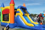 The bounce house kept children entertained all day.