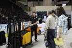 A NITCO staff member demonstrates the various uses for its wide variety of material handling equipment.