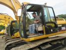 Dan Troiano of Equipment Sales and Leasing in North Haven, Conn., tries out this Cat 315CL.