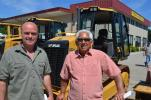 Bryn Smith (L) of The N.I.C.E. Company takes a hard look at this Cat tractor loader backhoe with Bill Rychlik of Christian Hill Farm and Equipment Sales in North Grafton, Mass.