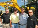 JCB of Chattanooga's Roger Wallen (L) and Woody Green (R) welcome their customers and friends Dennis Black and Jake Waddle of Black Concrete Construction, Cleveland, Tenn., to the event.