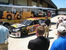 The Cat # 31 Chevrolet SS Sprint Cup car attracts a crowd.