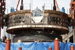 Photo/WSDOT The front end of Bertha, the SR 99 tunneling machine, is suspended above the tunnel access pit in this March 30, 2015 photo. The rest of the machine will remain in the ground while repairs are conducted at the surface.