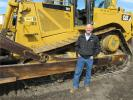 Bob Sitton of Darr Equipment, Southlake and Houston, Texas, checks out this Cat D8T.