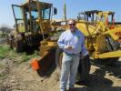 Steve Cone of Topway Materials in Newark, Texas, has just completed his check list on this Cat 160H motorgrader.