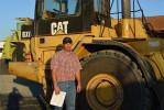 A good selection of articulated trucks brought Demo Mittry of Mittry Construction to the Los Angeles event.  Here he checks out the Cat D350E.  The Mittry family construction business is located in Redding, Calif.