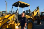 The New Holland backhoe loader got a long look from Tom Norvell of Southwest Development in Bakersfield, Calif.