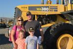 Mulcaire and Sons Contracting is a family-owned construction company in Camp Verde, Ariz.  The entire family was in Los Angeles for the auction.  Pictured with a Komatsu loader are owners Shanna (L) and Jess, along with their children Aislynn and Tristain