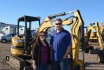 Alana (L) and Justin Lageschulte chose Ritchie Bros. to help liquidate more than 200 pieces from their former business S&M Rentals of Phoenix, Ariz.