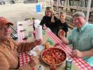 Ron Julian (far L) and Jeff Biggs (far R) of 4X Construction in Mansfield, Texas, teach Caleb and his mom Erin Dupee of REMU USA Inc. in Old Orchard, Maine, the art of eating crawfish.