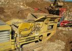 The Cummins Crushing & Recycling Extec C-12+ mobile jaw crusher is used for final crushed material.
