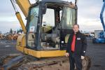 Zeb Seidel, Bar None CEO and auctioneer, paused in front of the Cat 308C that he would later sell to the highest bidder. Seidel commented that sales are brisk in Sacramento as well as at their other sites in Riverside, Calif., and Portland, Ore.