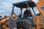 Ron Machado (L) of Rivercrest Ranches in Ripon, Calif., was on hand along with almond farmer Nick Alta, also of Ripon. Alta was looking for a backhoe and showed serious interest in the Case 580.