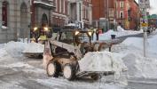 Jerry Jackson/Baltimore Sun photo  Contractors use Bobcats to remove snow in Baltimore.