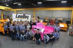The LeeBoy team that built the pink paver shows their pride by coloring the logos on their hats pink.