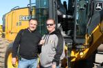 Checking out a John Deere 670G grader are Mike Iapaluccio (L), owner of J. Iapaluccio Incorporated, Danbury, Conn., and Chris Taylor of D&M Construction, also based in Danbury.