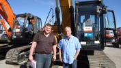 Travis Fox (L) and Larry Armstrong of Yancey Bros. give this Cat 315D a good look.