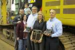 (L-R): Ken Scott, 1st Class mechanic, Ransome CAT; Denise Feger and her son, Carson Feger; and Mike Lineman, technical services supervisor, Kristin Bromley-Fitzgerald, Ransome CAT president, and Mike Rigby, shop floor manager (main shop), all of Ransome C