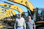 Hank Spies (L) of Milton CAT and Bart Rhea, owner of BKBC Machinery of Flemington, N.J.