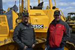 Purchased at the IronPlanet sale, a John Deere 70C LGP went home with James (L) and Robby Alberson of Robby's Equipment Sales, Widener, Ark.