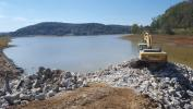 Sunesis Construction photo.  Sunesis Construction started work on the $31.7 million Lake White Dam Rehabilitation and Roadway Improvement Project, the reconstruction of 1 mi. (1.6 km) of state Route 104 (SR 104) that sits atop the dam, last August.
