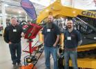 Bob Candee (L) of Fecon joins Gabe Clark and Tony Little at the Company Wrench equipment display to talk about the dealerships lineup of equipment.
