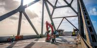 Caltrans photo. Dismantling of the old bridge started after traffic was moved onto the new structure.