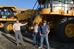 (L-R): Neal Davis, Jim Williamson and Ben Raffety of Barretts Minerals are on hand to bid on one of several Cat 775 rock trucks up for sale. Barretts operates a talc mine in Dillon, Mont.