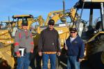 Buying equipment for their start-up construction business are (L-R) Sean Bratcher, Bobby Bratcher and Joe Becerra of Porterville, Calif. They were interested in this Cat 446B backhoe.