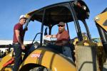 Jamison Riley (L) and Matt Hess of Urban Jungle Contractors, traveled from Boulder City, Nev., to bid on this Cat 420F backhoe loader.