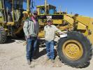 (L-R): Tommy Clark, Tractor Ranch Inc. of Wills Point, Texas, and Barry Burgess, Barry Burgess Equipment in Kemp, Okla., are pretty interested in this Cat 120K motorgrader.